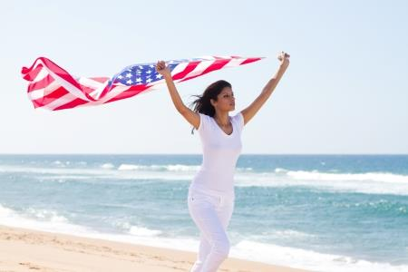 Woman Holding an American Flag